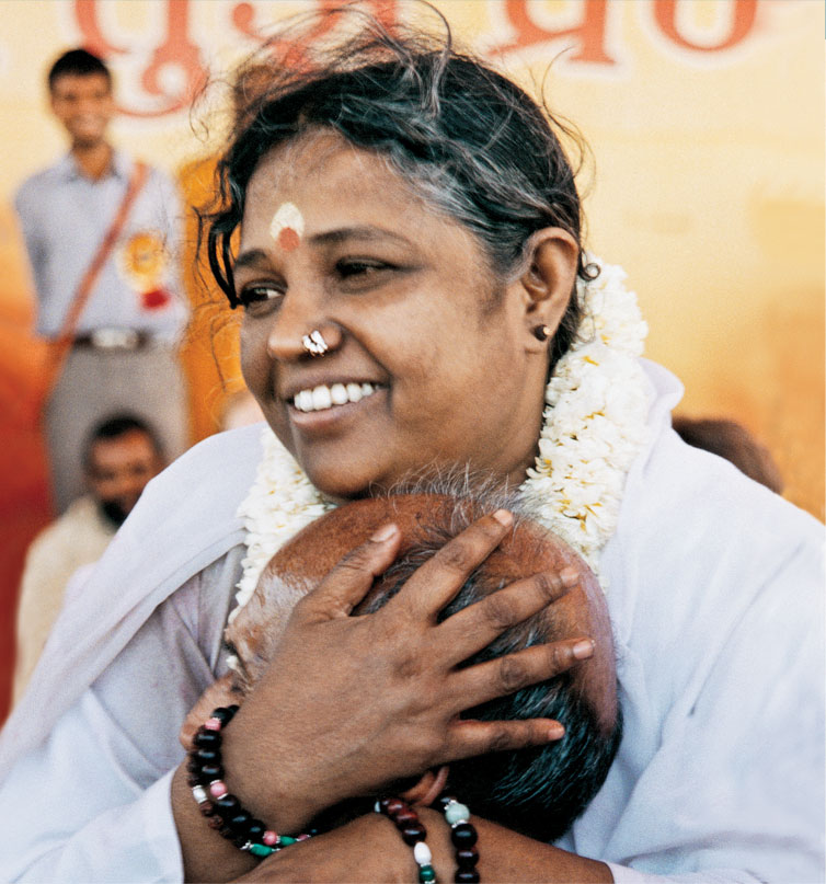 an examination of amma embracing the world
